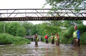 One of the U.S. Geological Survey teams collecting water samples and checking cages for fish eggs in Missouri this summer: biologist Diana Papoulias, chemist Dave Alvarez, hydrologist Peter Van Metre, biologist Diane Nicks and environmental toxicologist Don Tillitt.