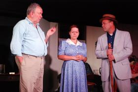 """Rich McCoy, Michelle Dearing and Jeromy Rees in """"The Rainmaker"""""""