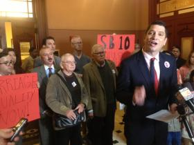 Gay rights activists hold a press conference before the end of the legislature's spring session, demanding the same sex marriage bill get a vote in the Illinois House.