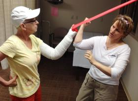 Verna Stallone gets tips on how to safely move her swollen arm as part of her personalized rehab program