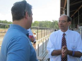 U of I Physics Professor and Congressional candidate George Gollin talks with Champaign Mayor Don Gerard at the Champaign County Fair Tuesday.