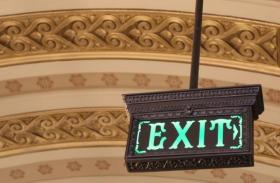 A new exit sign hangs in the west wing of the statehouse.