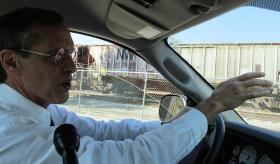 Jim Moll drives along 10 1/2 Street, which runs parallel to the Norfolk Southern rail yard