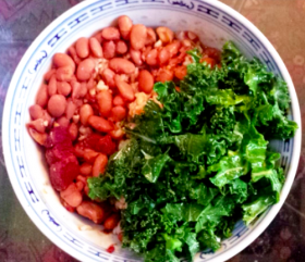 Monica Eng prepared rice and beans with kale salad for dinner on the SNAP challenge.