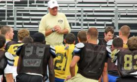 SHG Cyclones Head Coach Ken Leonard talks to his varsity players before an afternoon practice