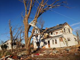 A tornado damaged home in Gifford, Ill.