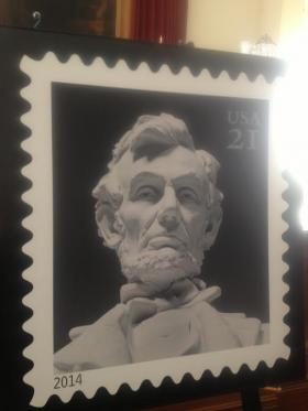 The new commemorative Lincoln stamp is worth 21 cents—not enough to mail a letter, but enough to cover an extra ounce of mail.