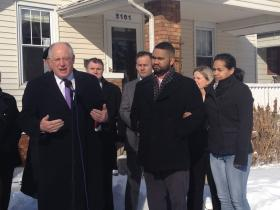 "Gov. Pat Quinn promotes the ""Welcome Home Heroes"" home loan program in front of Jonas and Angie Harger's home. The Hargers are pictured at right."