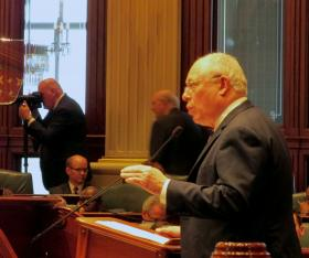 Gov. Pat Quinn delivers his annual budget address on the House floor Wednesday. In his speech, Quinn called for extending the 2011 income tax hike.