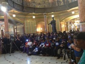 Minimum wage workers and union members rally for a higher minimum wage in the Capitol rotunda.
