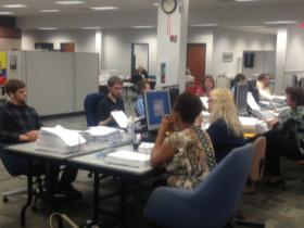 Illinois State Board of Elections employees work to verify a sampling of petition signatures for two citizen-initiated constitutional amendments.