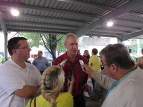 Republican candidates for governor Bruce Rauner, a former private equity investor, answers questions from the media at the Illinois State Fair Thursday evening.