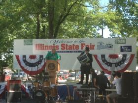 Gov. Pat Quinn's campaign debuted a new mascot at his Illinois State Fair rally, Baron VonMoneybags.