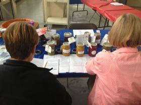 (Anonymous) judges taste some relishes entered into the 2014 Illinois State Fair contest.