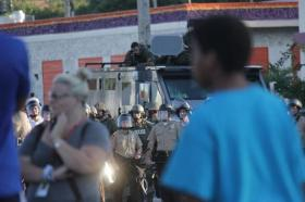 Local police in Ferguson use military style vehicles during protests on Aug. 12.