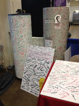AARP Illinois asked seniors to sign two water heaters to petition lawmakers to stop utility rate hikes. The group says the water heaters filled up in the first two days of the State Fair and the poster boards have filled up since.