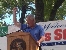 "Gov. Pat Quinn leads a chant of ""raise that wage!"" at his reception at the Illinois State Fair on Wednesday."