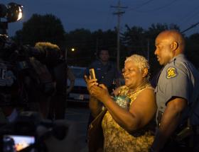 """The atmosphere was calm enough Friday night that several people asked for and took selfies with Capt. Ron Johnson."""