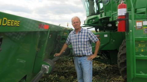 Illinois farmer Len Corzine is surrounded by some of his brand new farm equipment.
