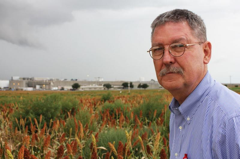 ": Don Stull, a University of Kansas anthropologist, stands outside the Tyson beef plant on the outskirts of Garden City, Kan. Stull has studied Garden City and other meatpacking towns for 30 years and is co-author of the book ""Slaughterhouse Blues."""