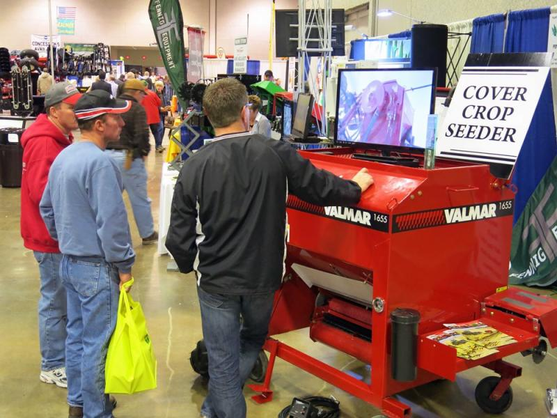Visitors to the Peoria Farm Show learn about seeding cover crops in this 2013 file photo (Peter Gray/WUIS)