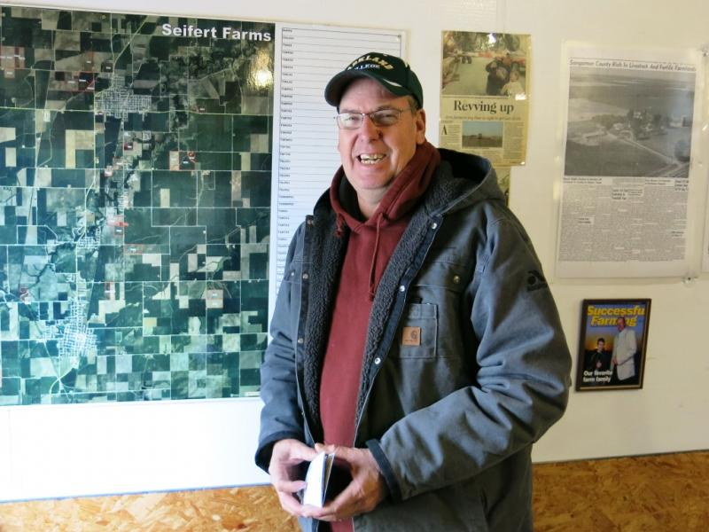 A map on the wall of farmer Tim Seifert's garage shows an aerial view of the dozens of corn and soybean fields his family harvests each year.