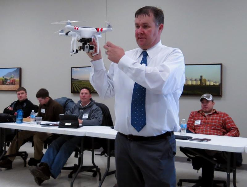 Chad Colby shows Midwest farmers how GPS controls the high-definition camera attached to the UAV.