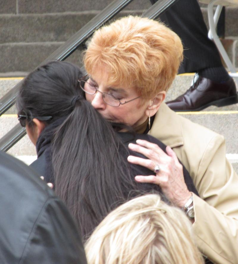 Comptroller Judy Baar Topinka (R) hugs a family member of Cook Co. Sheriff's Dept. Investigator Cuauhtemoc Estrada, killed in December protecting his family.