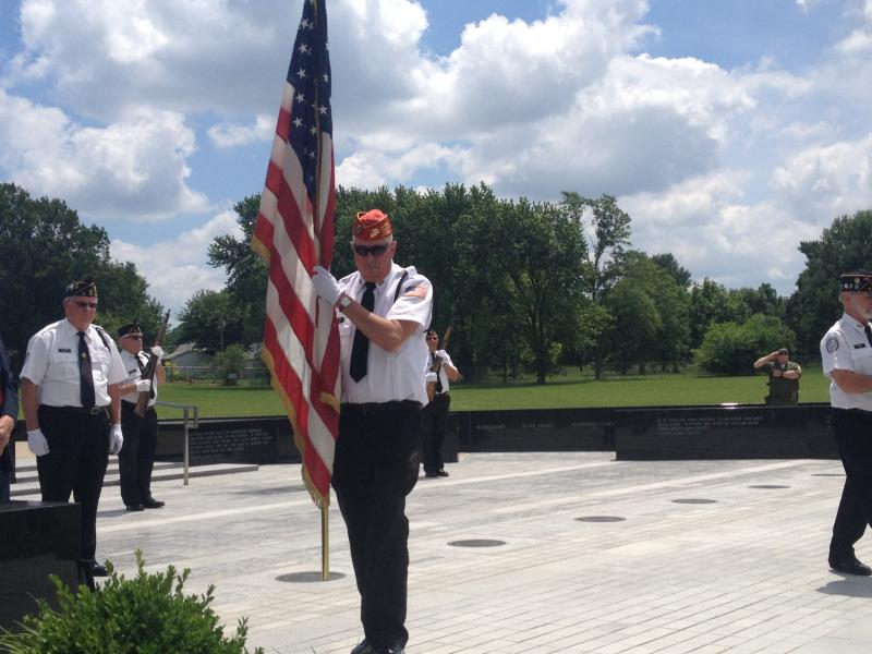 A colorguard puts the American flag in place for a D-Day memorial on Friday in Springfield.