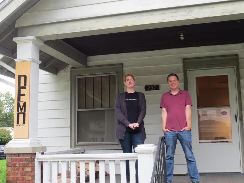 Allison Lacher & Jeff Robinson stand on the porch of DEMO