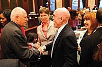Gov. Pat Quinn and Chicago Democratic state Rep. Greg Harris, sponsor of the same-sex marriage bill, celebrate after the House approved the measure.
