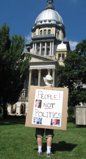 "woman at Capitol with ""People Not Politics"" sign"