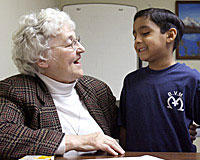 Sister Patty Fillenwarth tutors a first-grader from Maternity BVM school in phonics after school at Providence Family Services in Chicago.