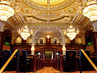 The Illinois House chamber uses a ventilation system that circulates air from columns in the chamber to the attic, where the air is filtered and dispersed over the lawmakers' desks.