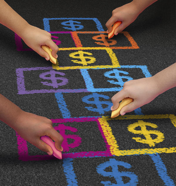 children's hands drawing dollar sign hop scotch with chalk