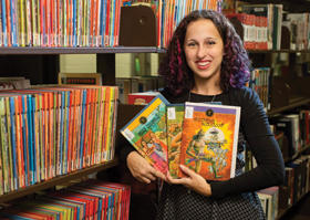 Mara Thacker holding comic books