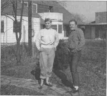 Lowery Handy and James Jones behind his home on the colony grounds