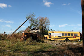 schoolbus and rural setting in disrepair