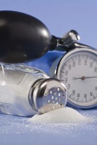 spilled salt shaker next to blood pressure gauge