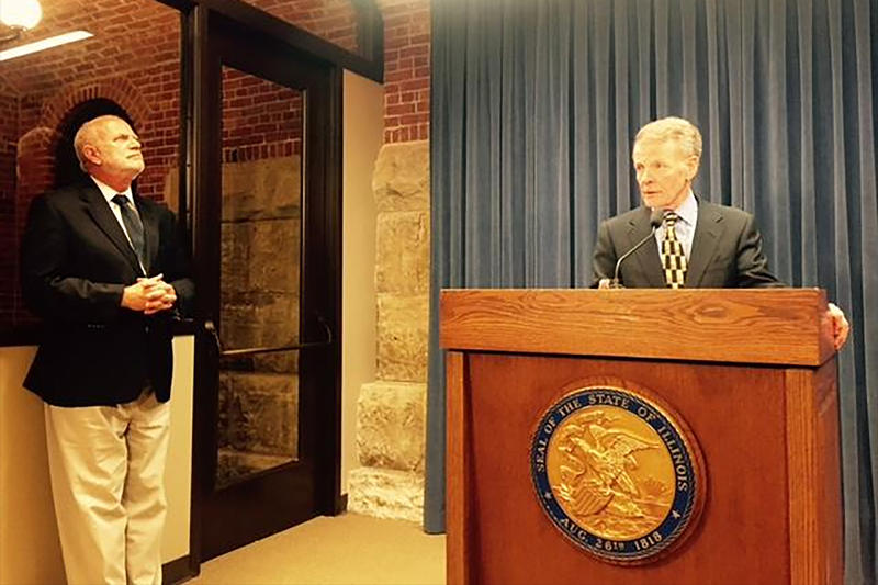 Steve Brown and Michael Madigan at press conference in statehouse blue room.