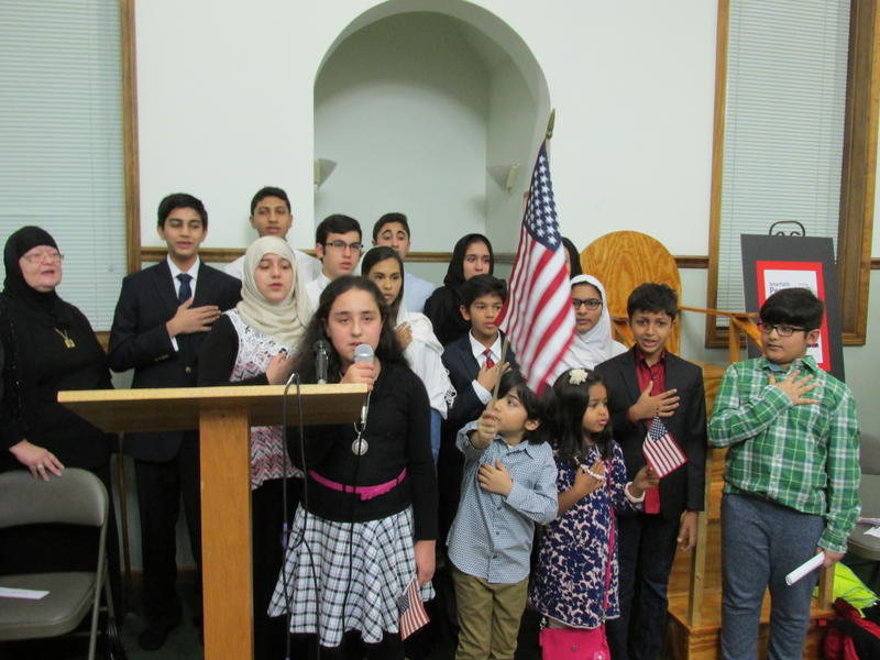 Muslim youth lead the pledge of allegiance & national anthem at the interfaith prayer vigil in Springfield