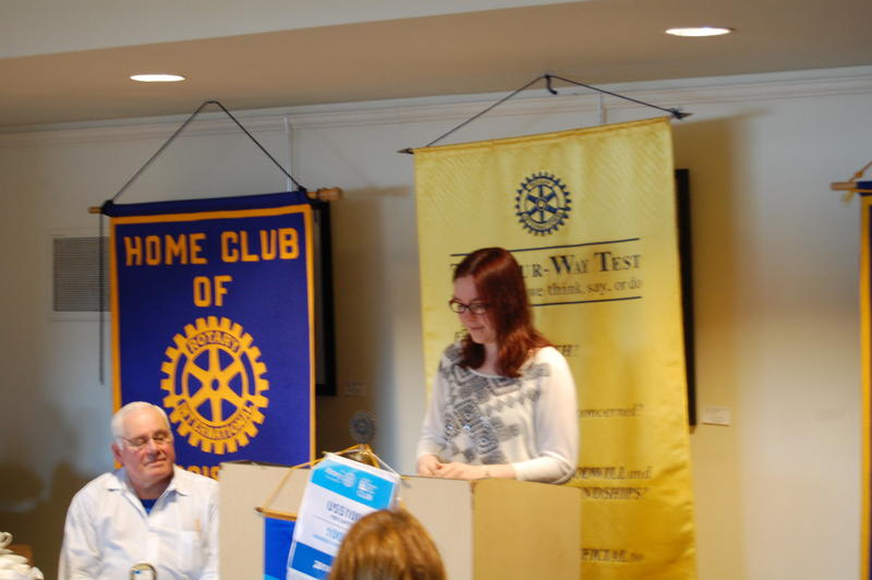 Lanphier High School Senior Janie Sutherd Reads Her Essay 'Dogs Can Learn New Trick, And Teach Them Too' For The Rotary Club Of Springfield Sunrise