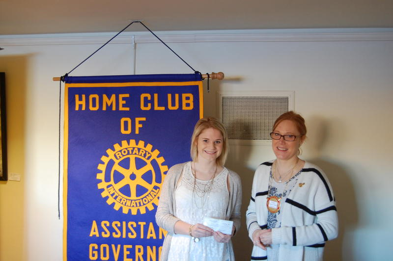 Riverton High School Senior Olivia Moore Recieves His Scholarship From The Rotary Club Of Springfield Sunrise