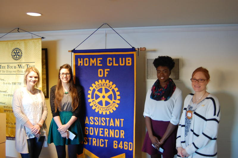 Olivia Moore (left), Hannah Mobley (center left), Ejehi Erewele (center right) pose for a picture with Carleen Hinkle of the Rotary Club of Springfield Sunrise