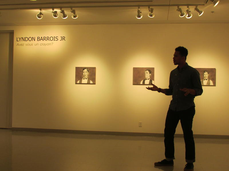 Barrois Jr. addresses a crowd during the opening of the exhibit