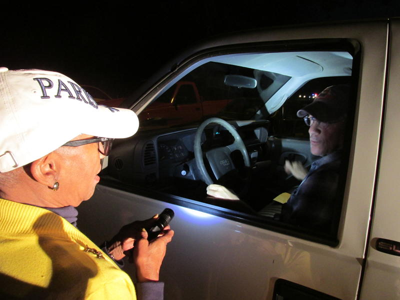 Kathryn Harris shines a light into the car Sgt. Castles drives during a mock pull-over