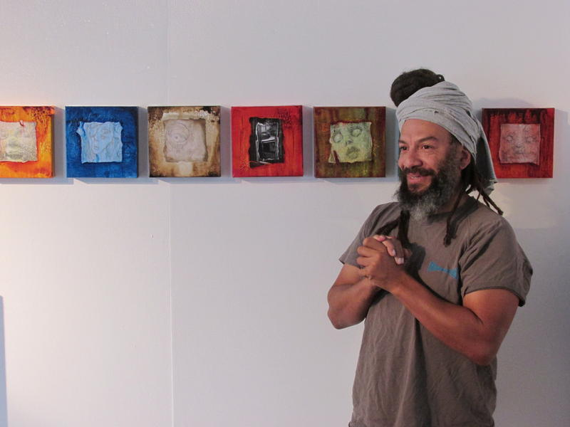 Jeff Williams stands in front of his creepy, cute art