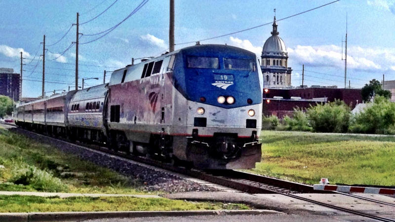 Amtrak train passes Capitol