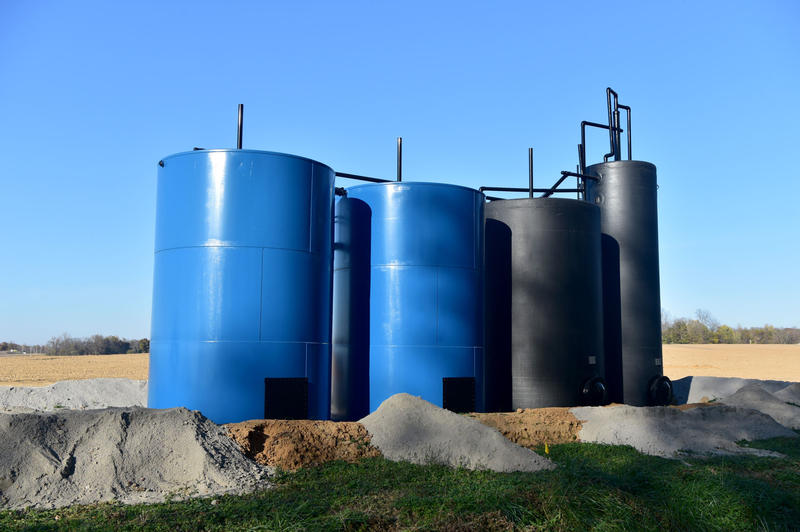 Tanks near an oil well on the edge of Grayville