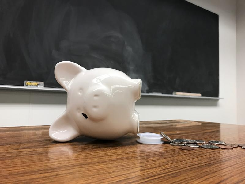 borken piggy bank on classroom desk